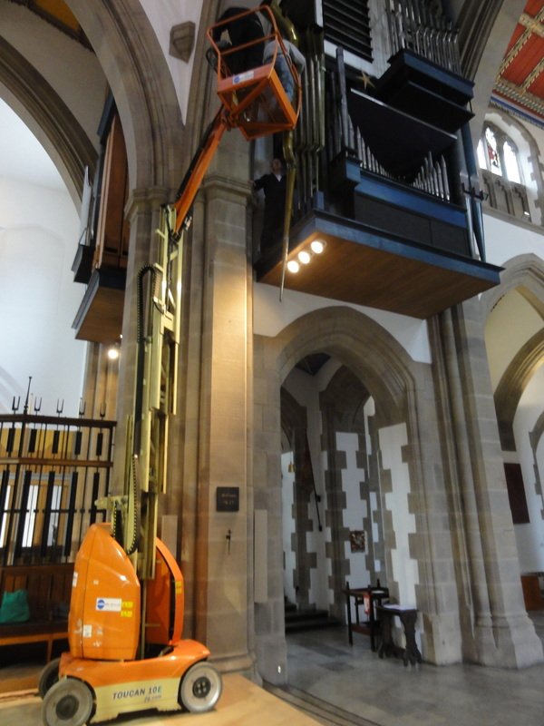 The damaged 32-foot serpent stop in the organ of Blackburn Cathedral is removed by David Wood for repair by Wood Pipe Organ Builders of Huddersfield