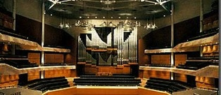 David Wood managing director wood pipe organ builders gives guided tour of organ in Bridgewater Hall, Manchester