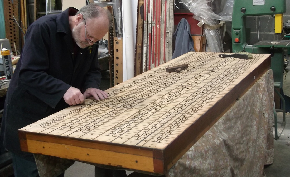 Paul Rayner at work on restoring a soundboard from the Binns organ in Christ Church, Great Ayton