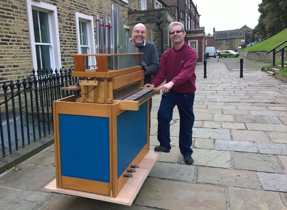 A chamber organ is wheeled into Fulneck Moravian Church, Pudsey.