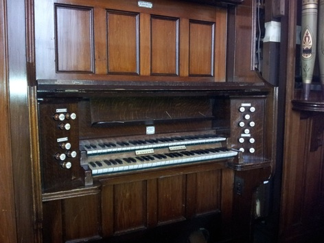 The organ console before restoration