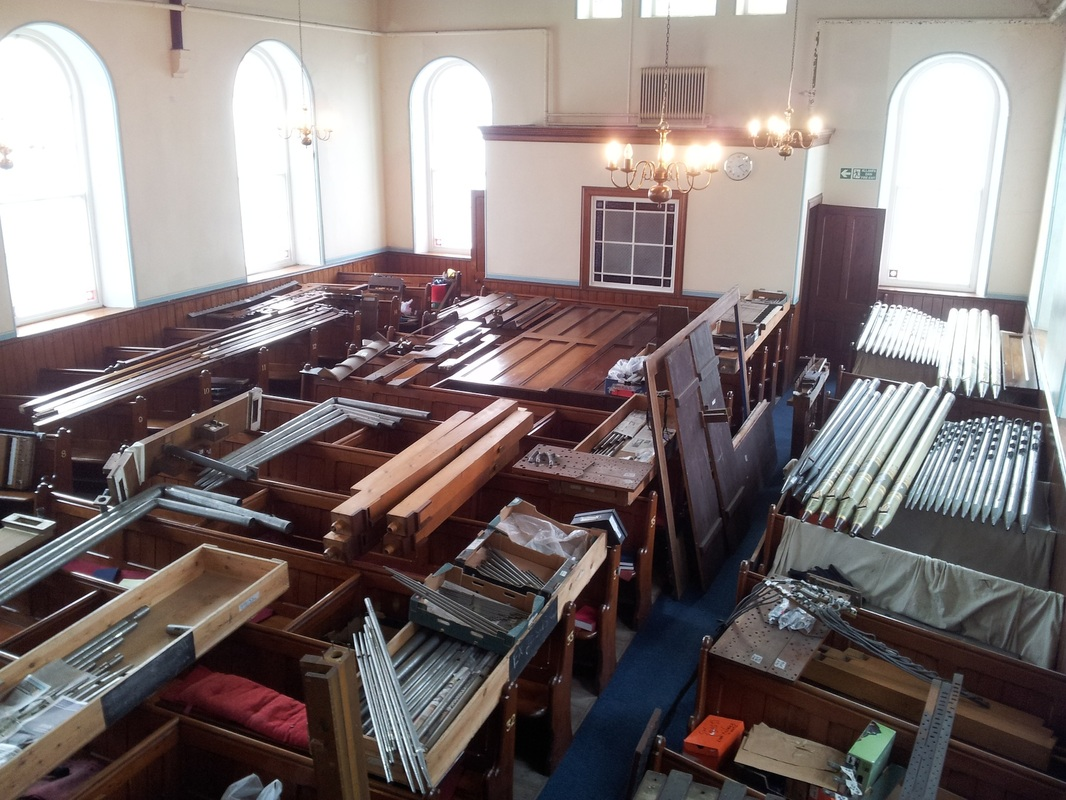 Organ pipes stored on the pew tops in Bethany Chapel