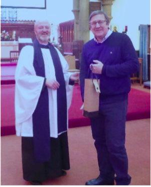 Organ builder David Wood accepts a gift from the vicar of Christ Church, Great Ayton