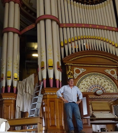 David Wood, managing director of Wood Pipe Organ Builders, surveys the pipes in Huddersfield Town Hall